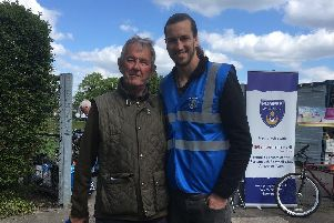 Steve Keyte with Pompey's Christian Burgess.