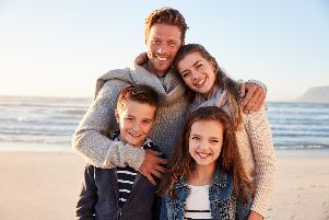They may look happy but they probably paid an absolute fortune to go on that beach vacation during the school holidays
