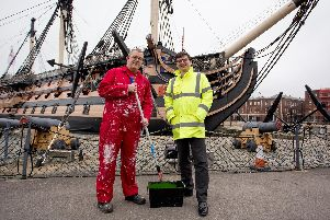 Historic ships painter Dave Bishop and Andrew Baines, Deputy Director of Heritage for the National Museum of the Royal Navy, in front of HMS Victory''Picture: Habibur Rahman