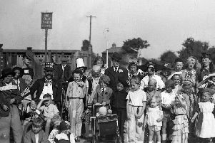 Children and adults in fancy dress celebrating VE Day outside The Oyster House, Locksway Road, Milton.