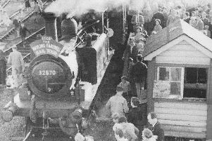 On  November 3, 1963 the final train ran to and from Hayling Island. Passengers surround the locomotive.