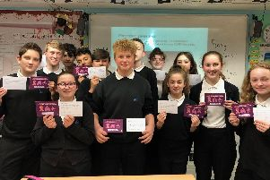 Admiral Lord Nelson School students with their postcard messages for MP, Penny Mordaunt.
