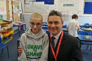 Fiorella Caraccio, 11, had her head shaved by head teacher, Mr Lyndon Strong, to raise money for Macmillon Cancer Support charity.