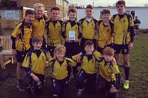 Boundary Oak School's under-13s rugby team celebrate after winning their first national tournament