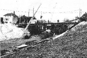 Looking north with the Portsdown Hill bridge under construction and the George Inn on the left. The lorries are on what became the re-aligned A3.