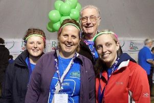 Alanis Sword (left) with her mum Micala (second left), Alan Symonds and Zoe Martindale at the Rowans Moonlit Memories walk in 2013