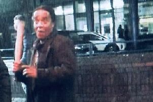Katiza Cebekhulu with a baseball bat in Guildhall Walk, Portsmouth. He was previously caught with a meat cleaver in Southsea 'Courtesy of CPS Wessex