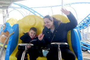 Gemma McKenzie and Afie 6 on the Tidal Wave rollercoaster in Southsea. Picture: Habibur Rahman