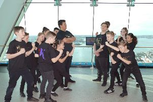 The cast of Bugsy Malone at The Kings Theatre square-up to each other at The Spinnaker Tower