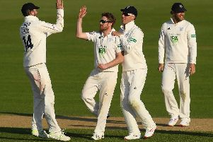 Liam Dawson celebrates bowling Joe Root against Hampshire. Picture: Mike Hewitt/Getty Images