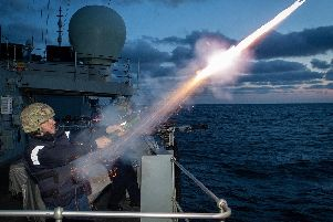 Sailors from HMS St Albans have been honing their night-shooting skills. Photo: Royal Navy