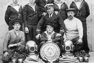 Men from HMS Emperor of India's diving team in the 1920s. Picture:  BR Webb postcard collection.