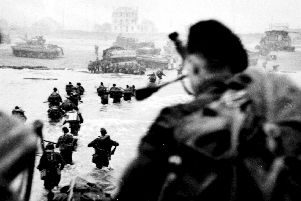 COURAGE: Troops wade ashore on D-Day
