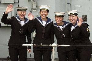 Female sailors wave as HMS Kent arrives home in Portsmouth