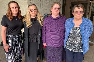 Pictured is Rebecca Wray outside Portsmouth Coroner's Court during the inquest into her father Anthony Walker's death. She is standing alongside her sisters Sarah Carro and Emma Harlow, and her mother Jennifer Walker. Picture: Ben Fishwick