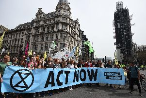 Extinction Rebellion protesters reach their final destination of Parliament Square in Westminster after marching from their camp at Marble Arch, London. More than 1,000 people have been arrested during the climate change protests in London as police cleared the roadblocks responsible for disruption in the capital.