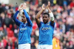 Nathan Thompson and Tom Naylor applaud the travelling Pompey faithful at Sunderland