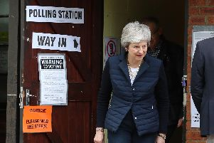 Prime Minister Theresa May leaves after casting her vote at a polling station near her home in the Thames Valley Picture: Andrew Matthews/PA Wire