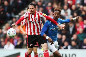 Jamal Lowe battles Bryan Oviedo for the ball at Sunderland earlier this season