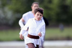 Ethan Hall, 8, on the charge at Portsmouth Lakeside parkrun on Saturday. Picture: Chris Moorhouse