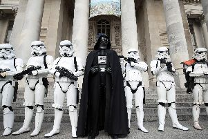 Copsplay actors dressed as Darth Vader and stormtroopers pose for a picture outside the Portsmouth Comic Con at Portsmouth Guildhall. Picture: Andrew Matthews/PA Wire