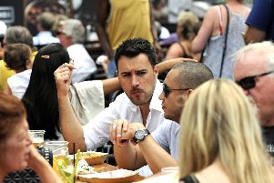 Punters enjoy tucking into a wide variety of seafood at last year's Seafood Festival at Gunwharf Quays. Picture Ian Hargreaves  (180701-1)