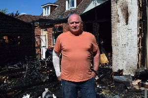 Colin Jones, 62, of Bedhampton, stands in his garden where a fire destroyed his shed, his neighbour's shed and damaged both their homes. Photo: Tom Cotterill