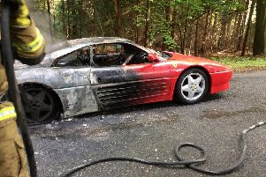 The Ferrari on fire in Hundred Acres Road. Picture: Hampshire Fire and Rescue
