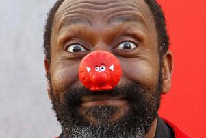 Photocall at The Royal Festival Hall to celebrate 25 years of Comic Relief. Lenny Henry plays to the cameras.