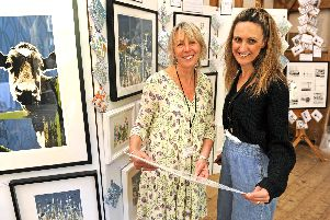 Artists and visitors enjoy the Hayling Island Arts Trail at The Barn in Northney. (left), Artist  Deborah Creasey with visitor Erica Marshall. Picture: Ian Hargreaves  (120519-5)