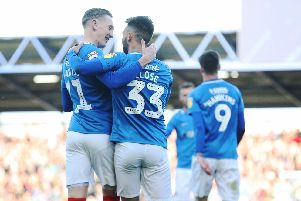 Portsmouth's Ben Close celebrates scoring his first goal of the match with Portsmouth's Ronan Curtis