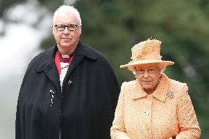 File photo dated 19/01/14 of Queen Elizabeth II, alongside the Bishop of Lincoln Christopher Lowson. Picture: Chris Radburn/PA Wire