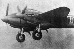 A refurbished Mosquito makes a low pass for the crowds.