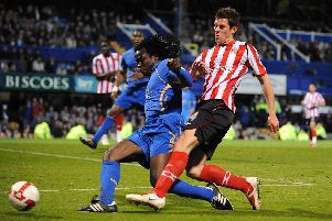 Linvoy Primus battles Sunderland's Daryl Murphy for the ball during his final Pompey appearance