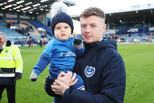 Dion Donohue, seen here with son Mason, has departed Fratton Park following two seasons on the south coast. Picture: Joe Pepler