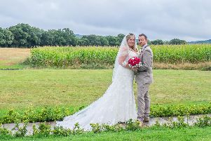 Claire and Nick Lodge on their wedding day. Picture: Carla Mortimer Photography