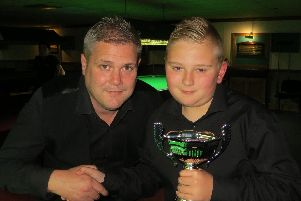 Samuel Laxton, right, picks up his trophy from professional snooker player Robert Milkins. Picture: Tim Dunkley
