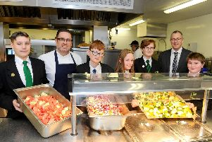 Pupils and staff in kitchen of the Park Community School, Havant, which will be coordinating free meals across the summer holidays.
