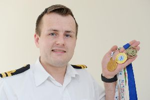 Jonny Davies holds some of his ice skating medals. Picture: Sarah Standing (230519-46)
