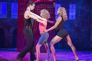 Michael O'Reilly (Johnny), Kira Malou (Baby) and Simone Covele (Penny) in Dirty Dancing. Picture by Alastair Muir
