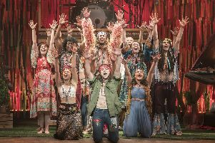 The cast of Hair The Musical, with Paul Wilkins kneeling, front-centre. Picture by Johan Persson