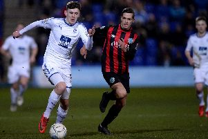 Ben Tollitt of Tranmere Rovers (left). Picture: Nathan Stirk/Getty Images