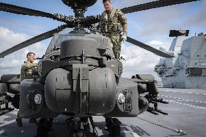 A Boeing AH-64 Apache from the British Army Air Corps has landed onboard HMS Queen Elizabeth for the first time. Picture: MoD