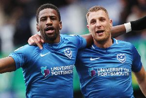 Omar Bogle, left, celebrates scoring against Scunthorpe with Lee Brown. Picture: Joe Pepler