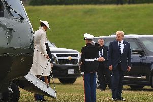 US President Donald Trump (R) and First Lady Melania Trump (L) disembark from the Marine One helicopter after arriving at Southsea Castle.