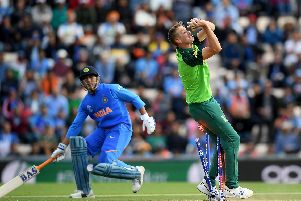 South Africa's Chris Morris collides with the stumps while taking the catch of MS Dhoni, of India, during the group stage match of the ICC Cricket World Cup 2019 between South Africa and India at the Ageas Bowl. Picture: Alex Davidson/Getty Images