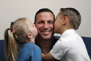 Major Andy Wilson will be trekking to the Everest base camp in October in aid of SSAFA. He is pictured here with his children, Aaron, 7, and Ruby, 3, at home in Stubbington.              Picture: Chris Moorhouse