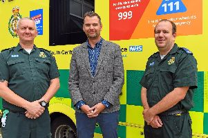 SCAS Technical Team Leader Dave Gardiner, left, with SCAS Emergency Care Assistant Chris Addoo who responded to an emergency call when Jamie (centre) collapsed just 400 metres from the finish line of the 2018 Great South Run on Southsea seafront Picture: Malcolm Wells (190610-2170)