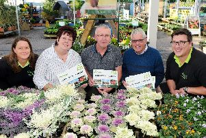 The winner and runners-up in The News, Portsmouth Bloomin' Marvellous competition, collected their gardening vouchers from Garsons garden centre in Titchfield. Pictured from left is:Clare James, director, Bethney Kelly from Gosport, Geoff Craig from Copnor, Ray Hunt from Purbook and Callum Hartley, plantsman. Picture: Sarah Standing (180798-7180)