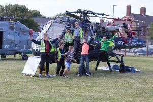 Victory Primary School pupils on a Wasp H.A.S 1. at the HMS Sultan show.